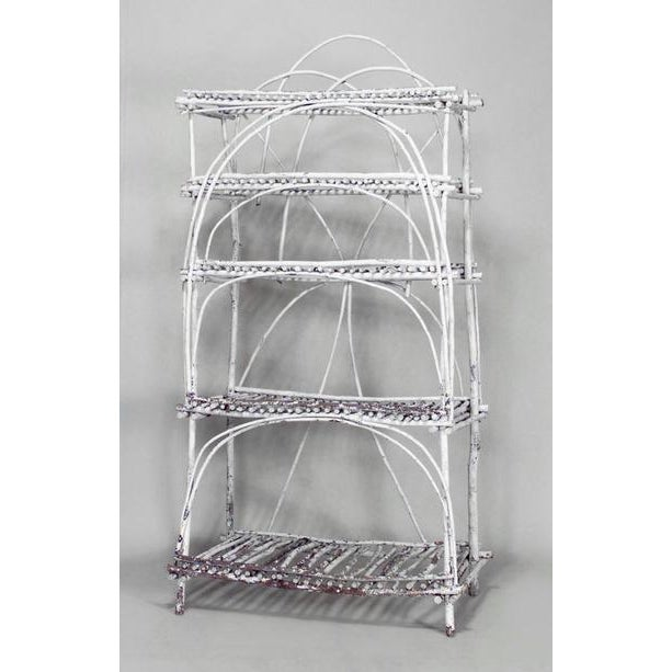 Rustic Adirondack (20th century) white painted twig design étagère with five slat shelves and open design.