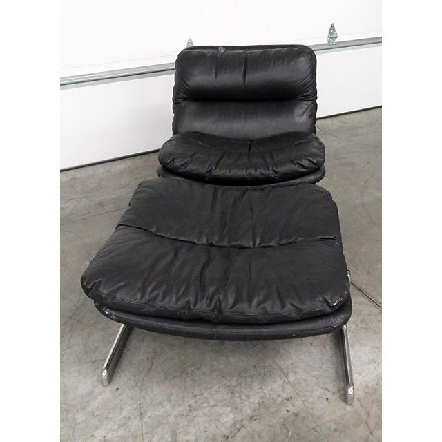 """Ammanati & Vitelli Italian distressed leather chair and ottoman with chrome bases. The ottoman measures 18""""h x 30""""w x 29""""d."""