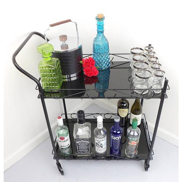 Awesome vintage cart that has been redone to fit into any modern home. Has two tempered glass shelves and wheels that roll...
