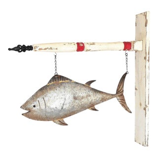 Hanging Metal Fish Sign on Wood Post