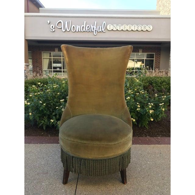 Pair of vintage velvet arm less slipper chairs. Green fabric & trim.