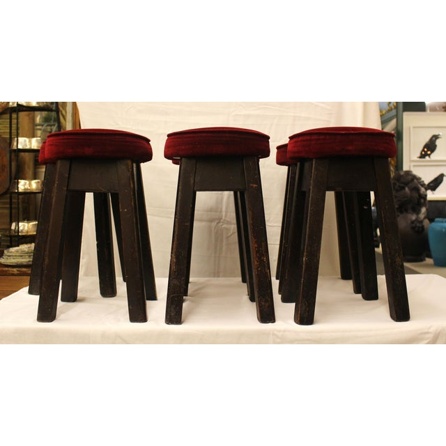 Solid oak bar stools with red velvet upholstered seat. From an English pub.