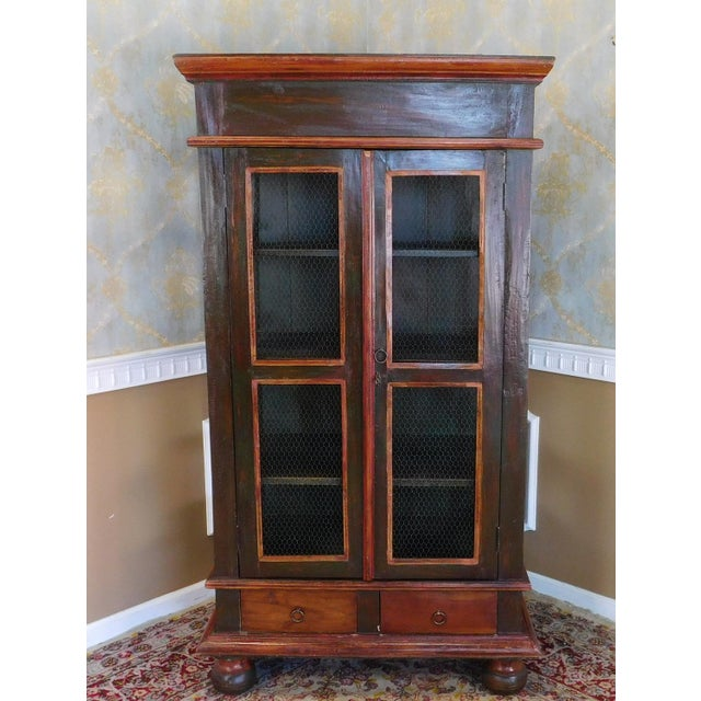 Description: This is a fantastic looking country primitive painted armoire. Heavy rustic construction with a heavily...