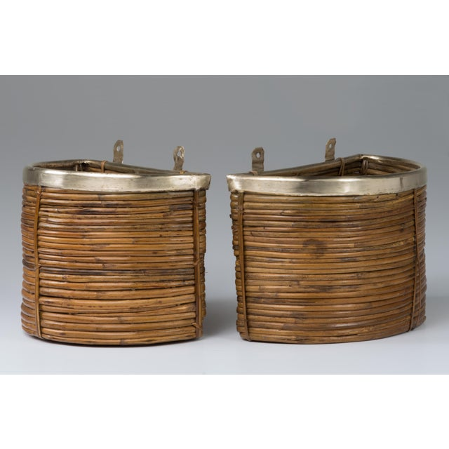 A pair of Mid century pencil reed hanging planters. Brass trim. Handmade with all the appropriate inconsistencies... The...