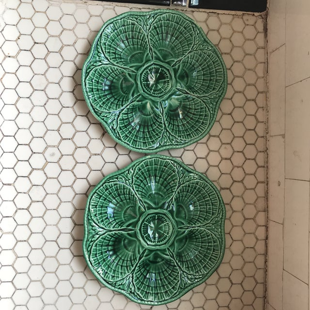 Pair of Vintage French oyster plates with basket-weave design. Green glazed finish. Stamped Sarreguemines, signed, and...