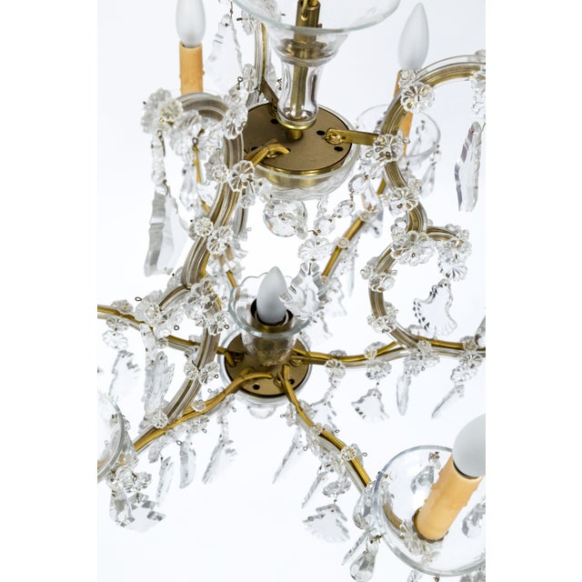 Created in the 1920's, this chandelier is beautiful example of the late 18th century Austrian Empress Maria Theresa style;...