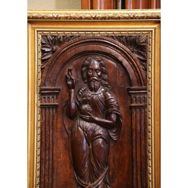 This antique sculpture was crafted in France, circa 1780. Set in a giltwood frame and carved of oakwood, the panel depicts...