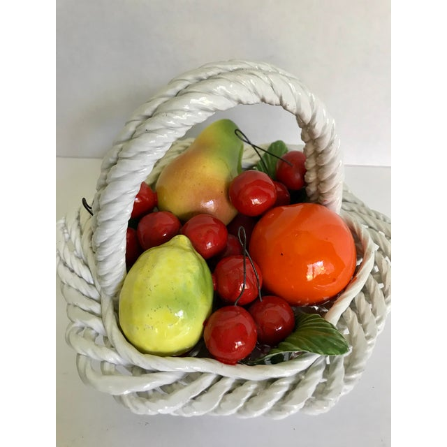 A very special piece with so much charm! Made of porcelain, the piece depicts a basket filed with fruit-a pear, lemon,...