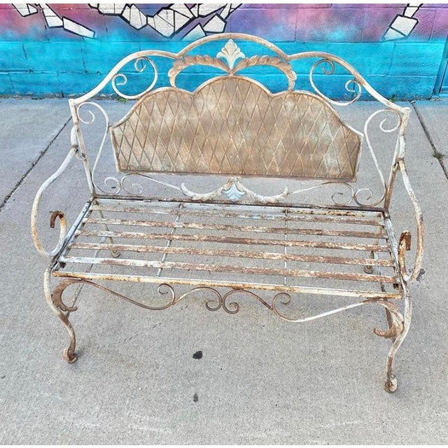 Vintage wrought iron bench that collapses for storage. Gorgeous early 20th century French detail and craftsmanship in the...