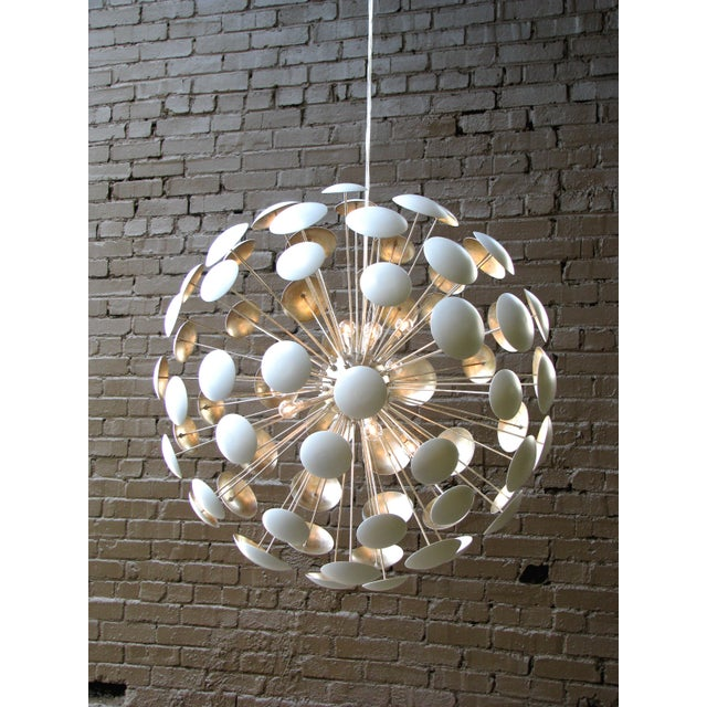 Add sophistication to your home with this beautifully designed, sputnik inspired chandelier. The medium sized chandelier...