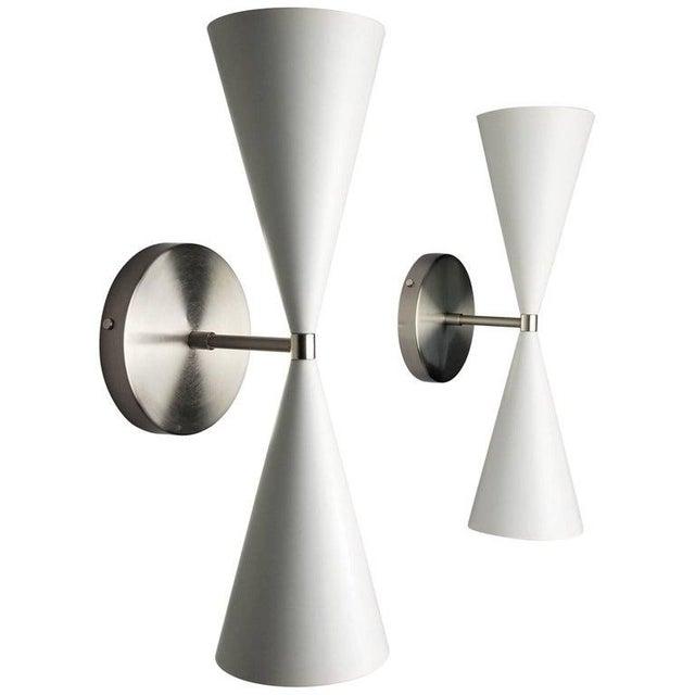 The tuxedo wall sconce or reading light shown in satin nickel and dazzling stark white enamel spun aluminium cones...