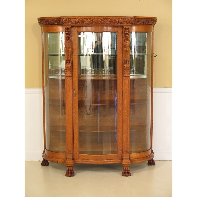 Offered Is An Antique Carved China Cabinet With A Serpentine Glass Door This Beauty
