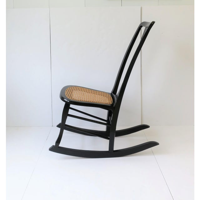 Wood Vintage Mid Century Black Lacquer and Cane Rocking Chair For Sale - Image 7 of 13