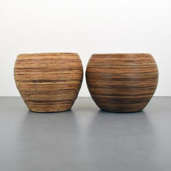 Pair of rattan lounge chairs designed in the manner of Gabriella Crespi.