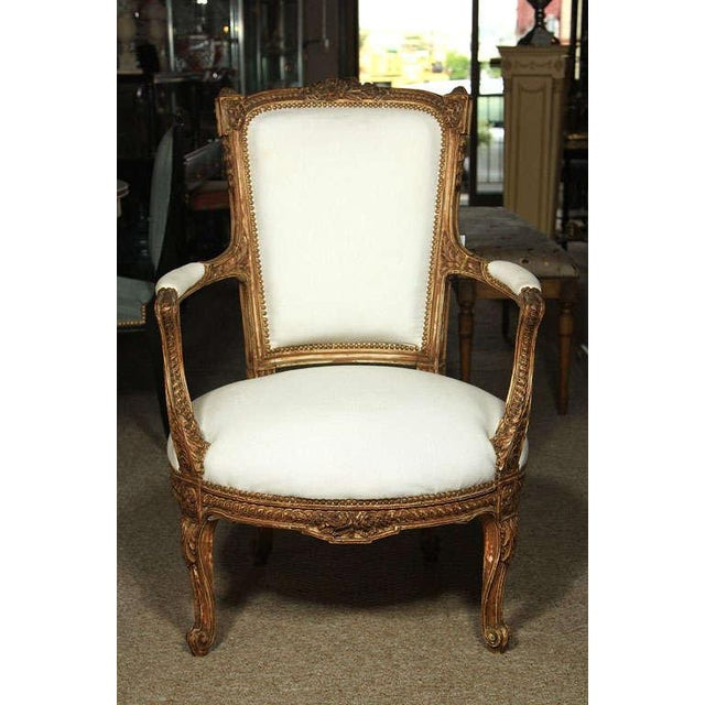 Pair of fine armchairs in the style of Louis XV. Beautifully carved frame in its original finish upholstered in muslin....
