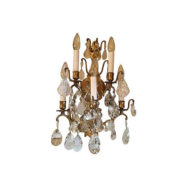 Pair of 1940s Italian five-pronged crystal and glass beaded sconces with brass arms and back detail. Wired for the USA;...