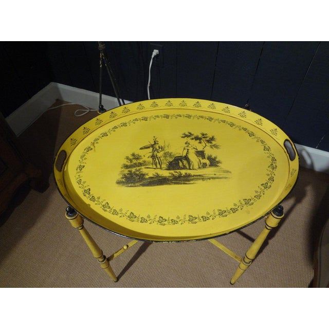 Charming Italian tole tray on stand in a great yellow color with a Neoclassical design from the 1940's.