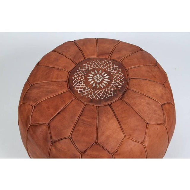 Large vintage round Moroccan leather pouf, handcrafted in brown camel leather. Hand tooled and embroidered on the top with...