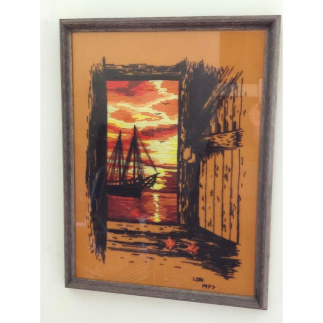 Fantastic framed fiber/yarn art with a sailboat image. Sunset colors and driftwood style framing, this piece would be...
