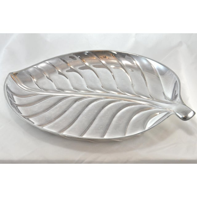 "Large 15 inch vintage silver plate leaf design tray. Marked: ""International Silver Company, 8199."" Light wear and patina."