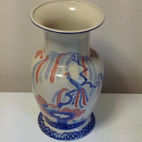 Large cream-colored ceramic vase with beautiful blue and orange, hand-painted design. A fun fusion of vintage and vibrant,...