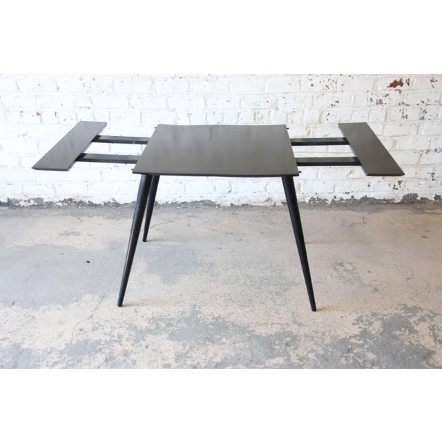"Offering a nice Paul McCobb Planner Group ebonized dinette table or game table. The table has two 10"" leaves that expands..."