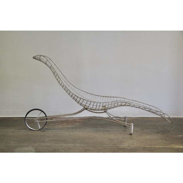 """An early 1950s indoor or outdoor powder-coated steel """"Capricorn"""" chaise lounge by Vladimir Kagan. Elegant curved form,..."""