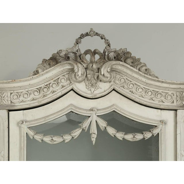 Antique French armoire from circa 1900 and still in its original painted surface. Currently the armoire has three large...