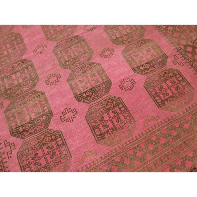 A rare 20th century one of a kind hand-woven Tribal Ersari carpet in predominantly bright pink. Not to be mistaken with an...