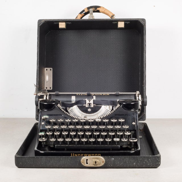 """ABOUT An antique """"Underwood Universal Portable Typewriter"""" with a 10 inch carriage, original case, original key and..."""
