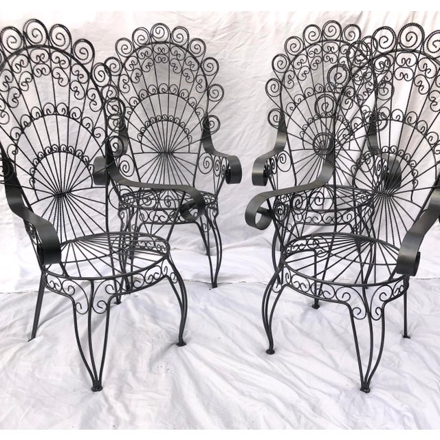 Beautiful rare set of 4 vintage Salterini style twisted scrolling peacock back wrought iron outdoor chairs