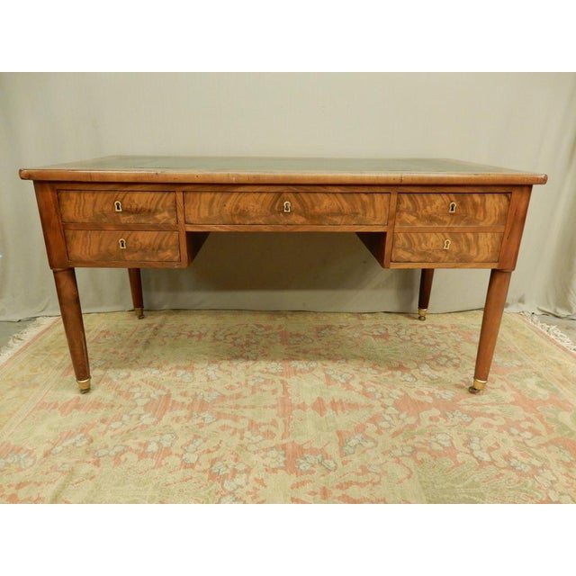 19th century Louis XVI leather top walnut desk with slides on each side. Four drawers with one interior fitted with slots...