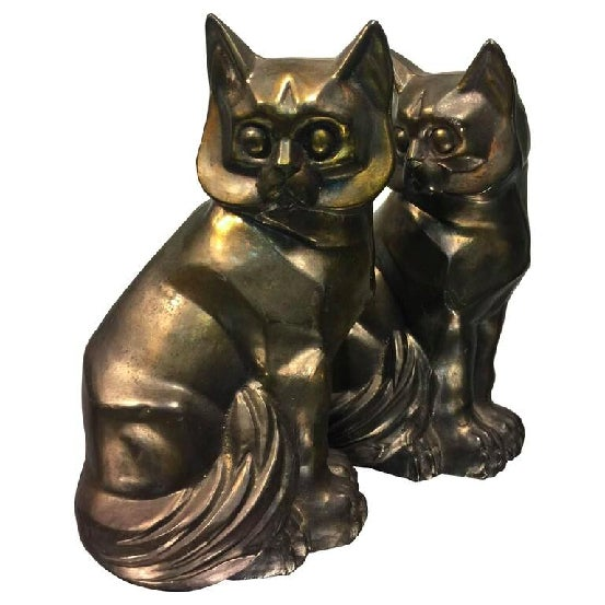 A terrific pair of Art Deco cast metal cubist cat form bookends, circa 1930's.Good condition with age appropriate wear.