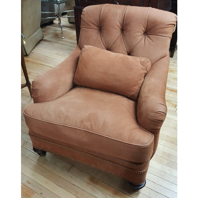 This is a floor sample that has the optional lumbar pillow. It is an orange brown leather. Never been used, has some...