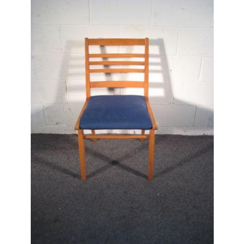 """Tight and sturdy with a blue seat. Light scratches and wear to legs. Seat height 19""""."""