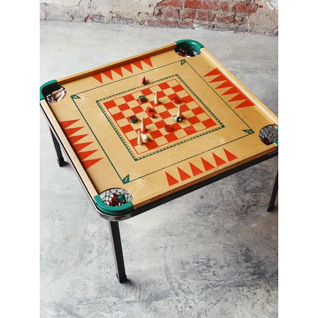 Long nights around this reversible game table (all pieces counted for and included). Early 50's era that included a book...