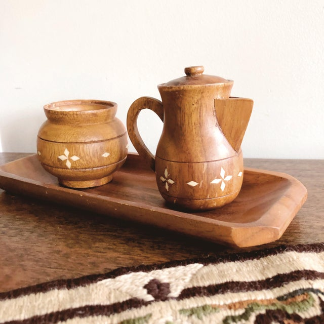 Vintage Indian small wooden coffee service set with inlaid shell. Includes a narrow wooden tray, a sugar jar, and a lidded...