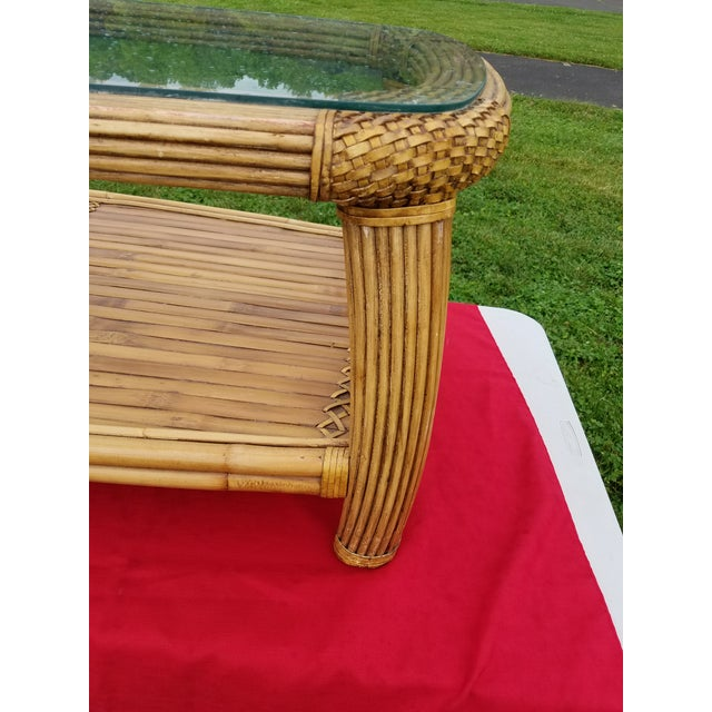 Excellent large pencil reed, split bamboo and rattan cocktail or coffee table. Lower shelf is split bamboo with cane...