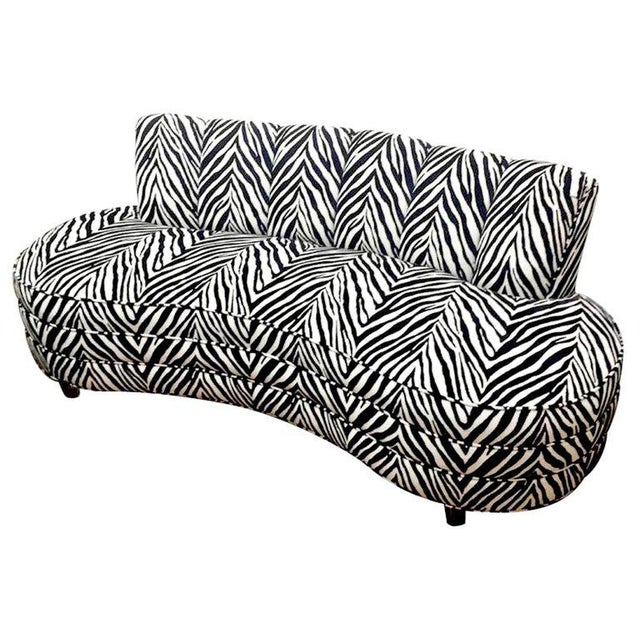 Custom midcentury Kagan style zebra pattern sofa, each one of iconic form, raised on Lucite legs. Sold individually.