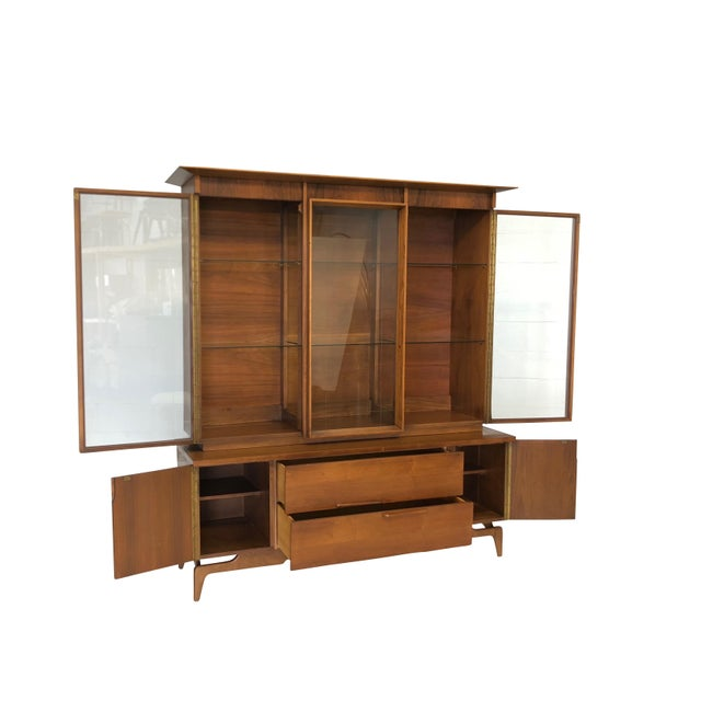 Mid Century Modern Atomic age credenza sideboard and hutch. Made of walnut with retro lines and unique design. Front has...