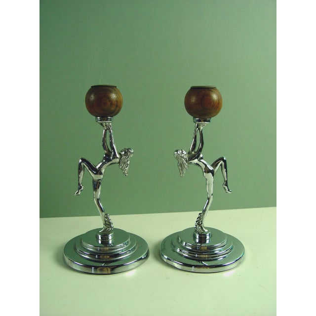 "Pair of vintage 1930s chrome and wood candlesticks. Dancing nude figure on stepped base. Bases, 4""Dia. Figures, 5.5""H x..."