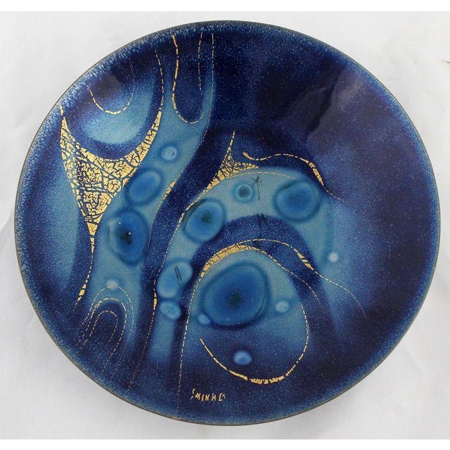 Phenomenal brilliant royal blue enameled plate by Sascha Brastoff. This incredible abstract mid-century modern piece of...