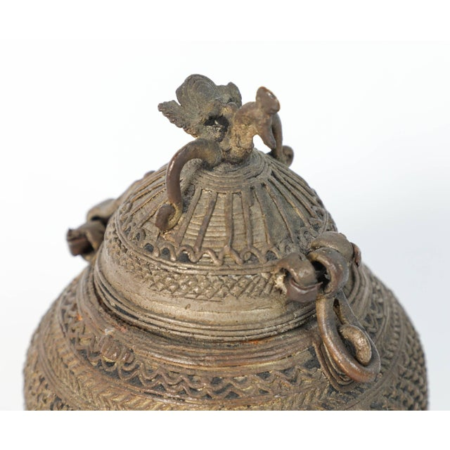 An extraordinary, old lost wax cast bronze box from India, possibly Orissa. Constructed as a cage made from many rolled...