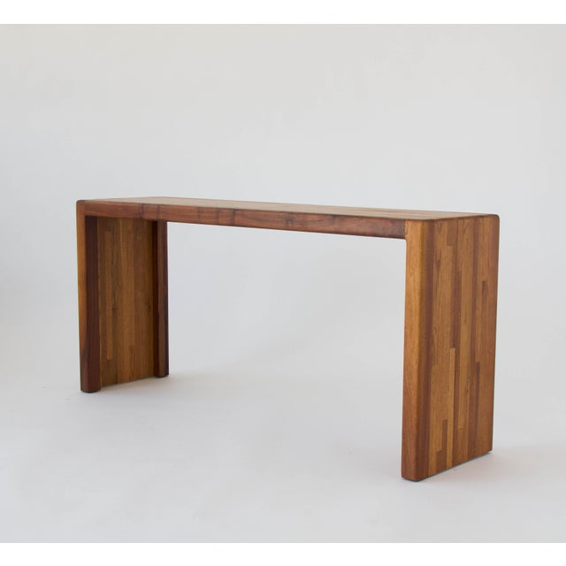 A slab-style console table designed by the San Diego-based Lou Hodges for California Design Group. The table has a solid...
