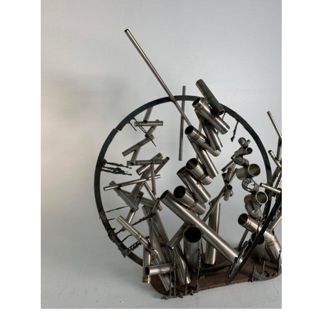 """A welded steel table sculpture """"Gates"""" by David Phillips. Acquired from the collection of the artist. Trained as an..."""