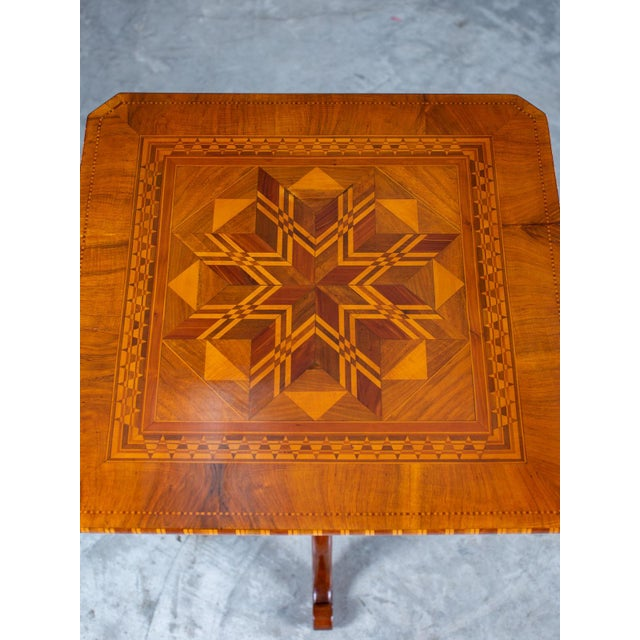 """A handsome antique Italian """"Sorrento"""" inlaid pattern top table circa 1880. The powerful inlay design on ten square top of..."""