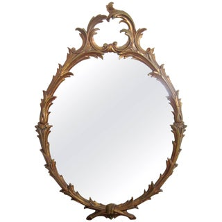 Mid-20th Century Italian Oval Gold Giltwood Wall Mirror For Sale