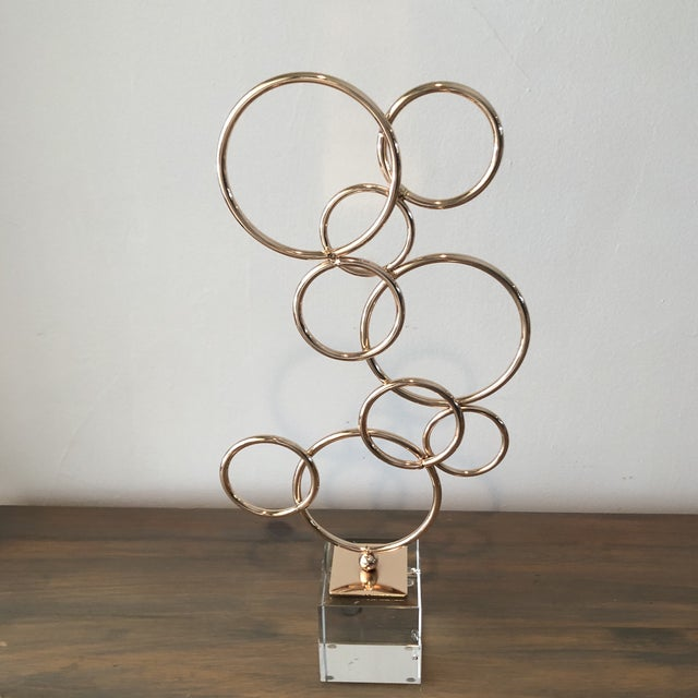 Beautiful sleek copper mountain sculpture on top of Lucite cube great decorative piece was from a sale out of Miami condo.