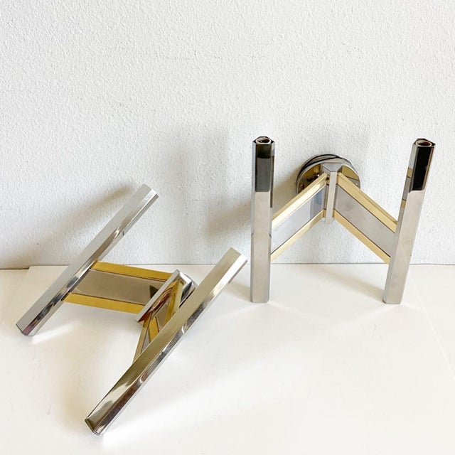 Sculptural pair of two-arm Italian sconces by Sciolari featuring sleek chevron-style arms of polished chrome and brass...