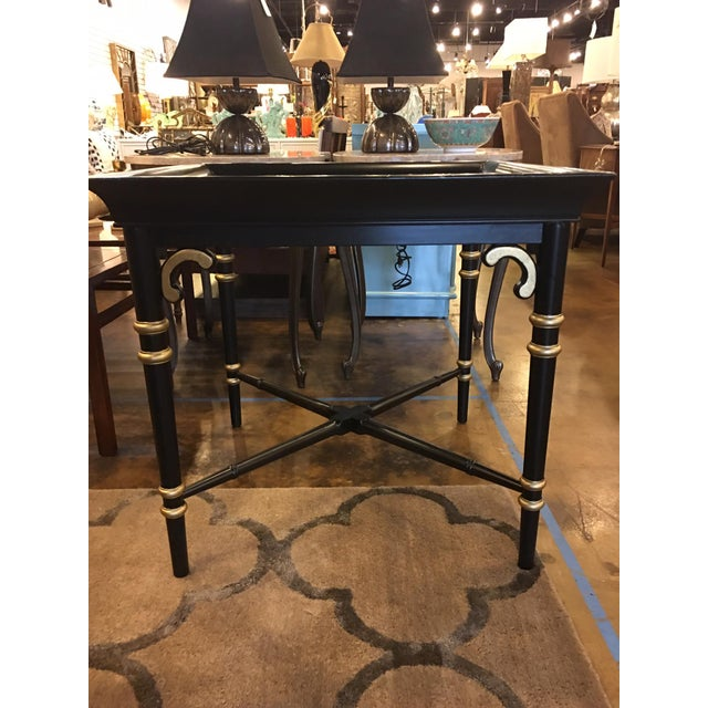 This table is vintage Maitland Smith and is a bit of an unusual size. It has been professionally lacquered in a satin...